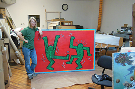 Christyl Cusworth in the studio with artwork