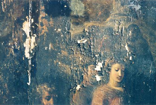 Flaked peeling painting on wood panel